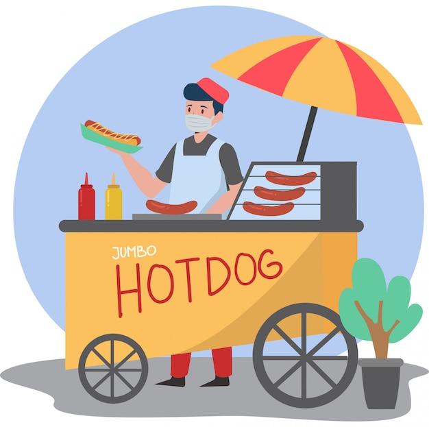 Mężczyzna sprzedający hotdoga u hotdoga hawkera, wciąż używając maski medycznej