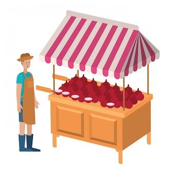 Mężczyzna sprzedawca warzyw z ikona na białym tle kiosku