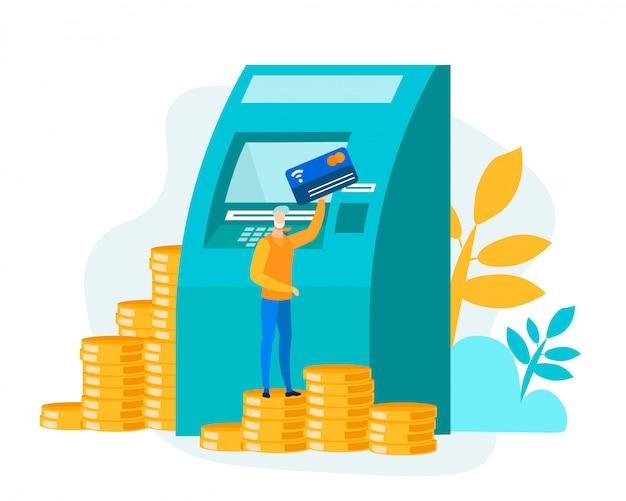 Mężczyzna stojący na stos monet z kartą w pobliżu bankomatu
