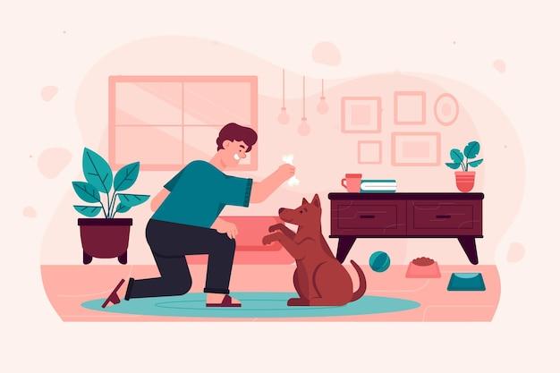 Mężczyzna trenuje swojego psa robić sztuczki