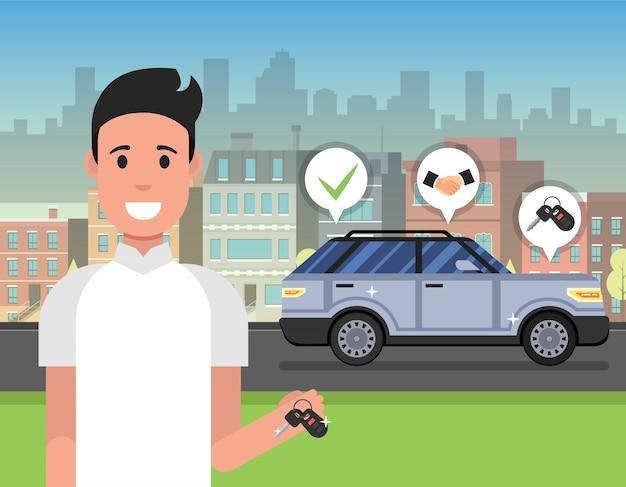 Mężczyzna trzyma klucz od nowego samochodu