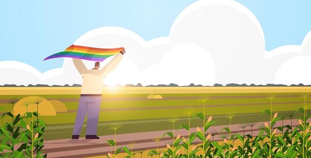 Mężczyzna trzyma lgbt tęczowa flaga wesoły lesbijka parada parada duma festiwal transpłciowa koncepcja miłości krajobraz tło poziome pełnej długości ilustracja wektorowa