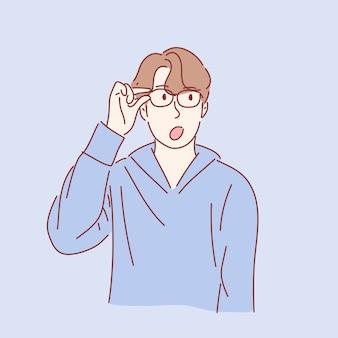 Mężczyzna trzyma okulary w koncepcji niespodzianki w wyciągnąć rękę