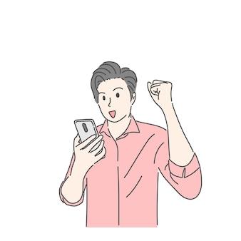 Mężczyzna trzyma smartfona i podnosi rękę w udanej, szczęśliwej, cieszącej się koncepcją