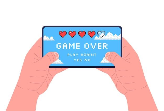 Mężczyzna trzyma smartphone i gra. pikselowa sztuka. koniec gry na ekranie. ilustracja wektorowa.