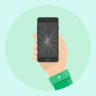 Mężczyzna trzyma telefon z pękniętym ekranem. zepsuty smartfon w dłoni