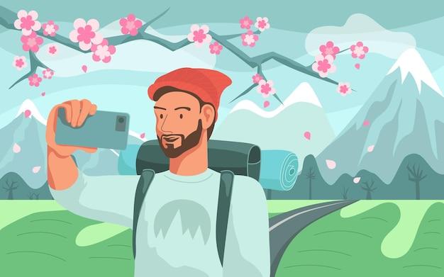 Mężczyzna turysta z plecakiem biorąc selfie na wiosnę górski krajobraz i gałąź kwiat. płaska ilustracja