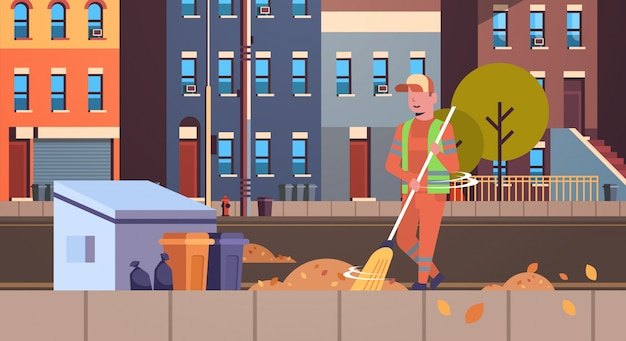 Mężczyzna ulicy sprzątaczka w mundurze za pomocą miotły zamiatanie śmieci