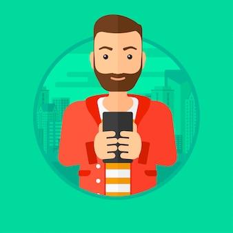 Mężczyzna używa smartphone.
