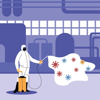 Mężczyzna w garniturze dezynfekujący przemysł przez covid-19