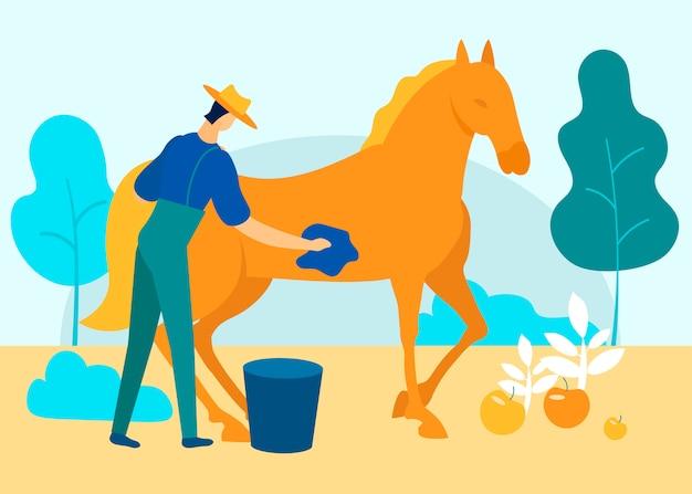 Mężczyzna w kombinezonie myje konia w ogrodzie. wektor.