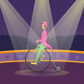 Mężczyzna w kostiumu klauna jeździ retro rowerem na scenie cyrkowej