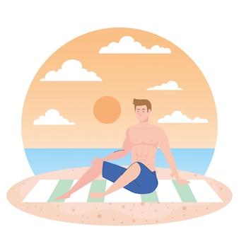 Mężczyzna w krótkich spodenkach siedzi na plaży, sezon letni