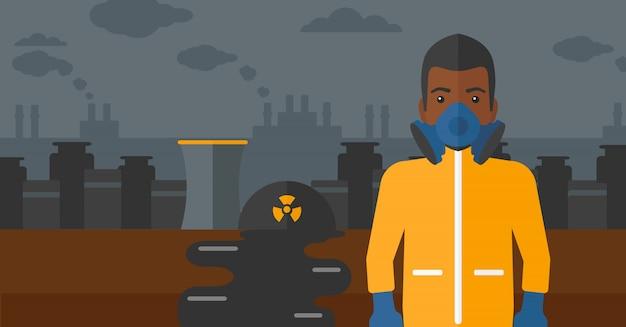 Mężczyzna w ochronnym kombinezonie chemicznym.