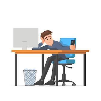 Mężczyzna w pracy czuje się znudzony