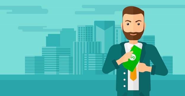 Mężczyzna wkłada pieniądze w kieszeń.