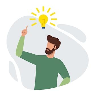 Mężczyzna wskazujący na jasną żarówkę, mający świeży pomysł i szukający rozwiązania problemu