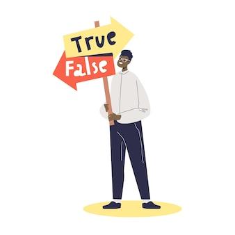 Mężczyzna wybiera kierunek prawdziwy lub fałszywy. pojęcie złej decyzji, nawigacja. kreskówka mężczyzna postać trzyma znak drogowy ze strzałkami.