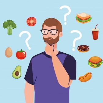 Mężczyzna wybiera między zdrową i niezdrową żywnością, fast foodem a zbilansowanym menu