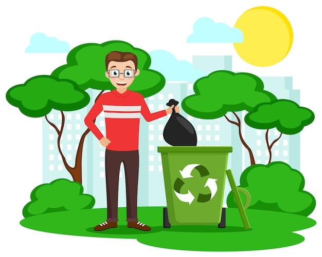 Mężczyzna wyrzuca czarną torbę do kosza na tle przyrody i miasta. ekologia