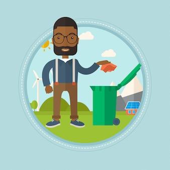 Mężczyzna wyrzuca śmieci