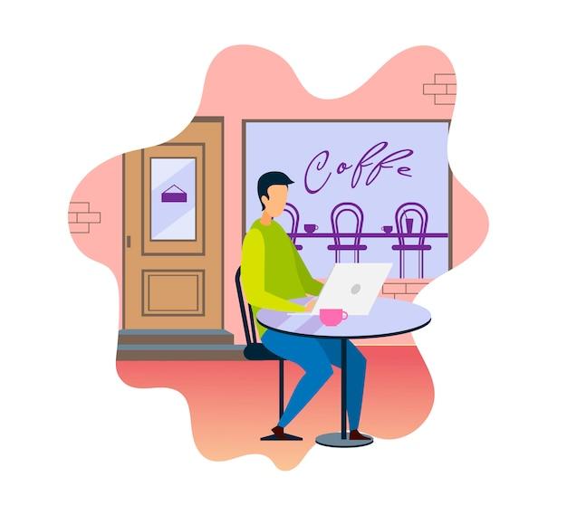 Mężczyzna z laptopem cieszy się gorącą kawę w sklep z kawą