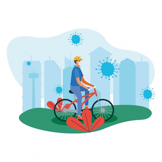Mężczyzna z maską na rowerze przy miastem