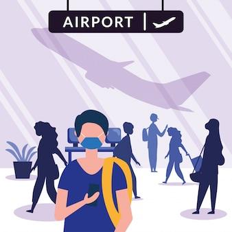 Mężczyzna z maską przy lotniskiem