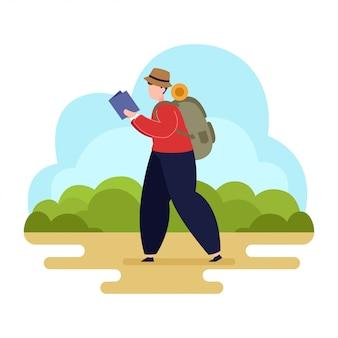 Mężczyzna z plecakiem spójrz na mapę