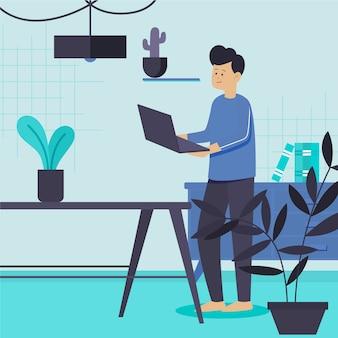 Mężczyzna z roślinami w pomieszczeniu, trzymając swojego laptopa