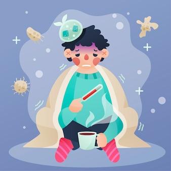 Mężczyzna z zimnem trzyma termometr i pije herbaty