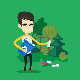 Mężczyzna zbiera śmieci w lesie.
