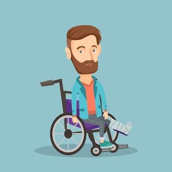 Mężczyzna ze złamaną nogą siedzi na wózku inwalidzkim.