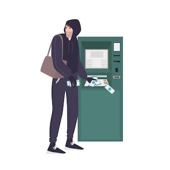 Mężczyzna złodziej kradnący banknoty z bankomatu