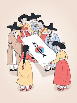 Mężczyźni i kobiety noszący tradycyjne koreańskie stroje, hanbok. ludzie trzymający papier.