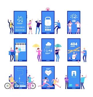 Mężczyźni i kobiety stojący w pobliżu dużych telefonów komórkowych z aplikacjami mobilnymi na ekranie.