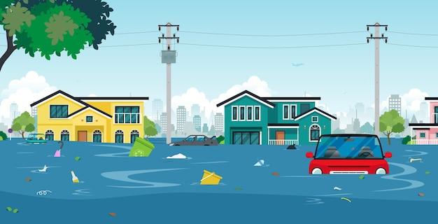 Miasto powodzi i samochody ze śmieciami unoszącymi się w wodzie.