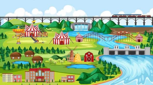 Miasto z parkiem rozrywki i sceną krajobrazową po stronie rzeki