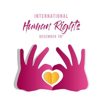 Międzynarodowe prawa człowieka i ręce z motywem serca, motyw z 10 grudnia.