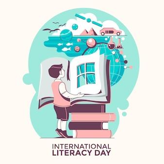 Międzynarodowy dzień alfabetyzacji z chłopcem i książkami