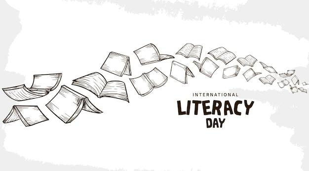 Międzynarodowy dzień alfabetyzacji z latającymi książkami na białym tle