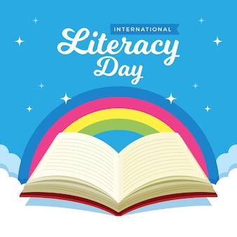 Międzynarodowy dzień alfabetyzacji z tęczą i otwartą książką