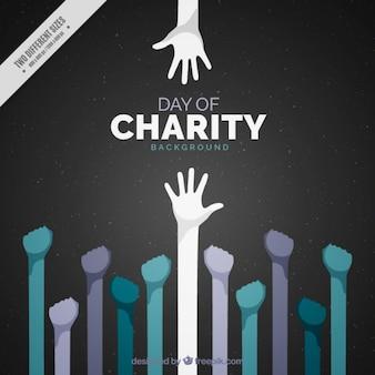 Międzynarodowy dzień charytatywny z podniesionymi rękami