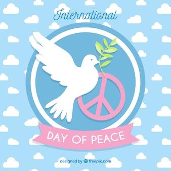 Międzynarodowy dzień pokoju, gołąb z gałązką oliwną i symbolem pokoju