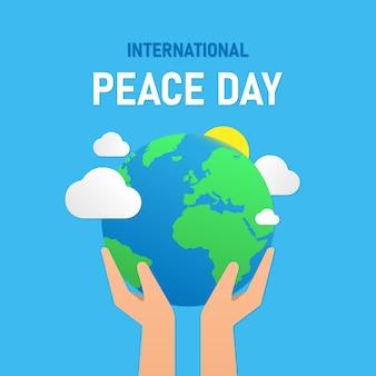 Międzynarodowy dzień pokoju. planeta ziemia w rękach. wektor eps 10