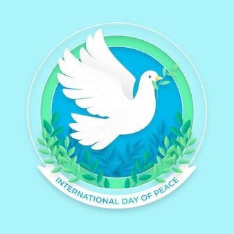Międzynarodowy dzień pokoju w stylu papierowym z gołębicą