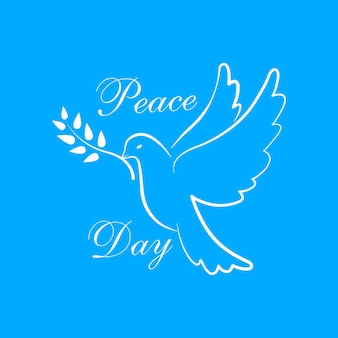 Międzynarodowy dzień pokoju z gołębiem. symbol gołąbka pokoju. gołąb z gałązką oliwną.