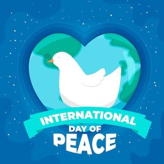 Międzynarodowy dzień pokoju z planetą w kształcie serca i gołębicą