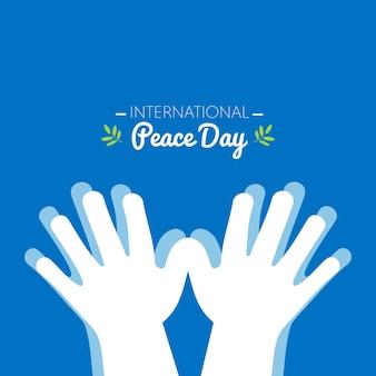 Międzynarodowy dzień pokoju z rękami tworzącymi kształt gołębicy
