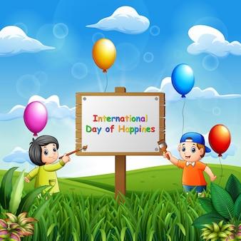 Międzynarodowy dzień szczęścia w tle z malowaniem dzieci